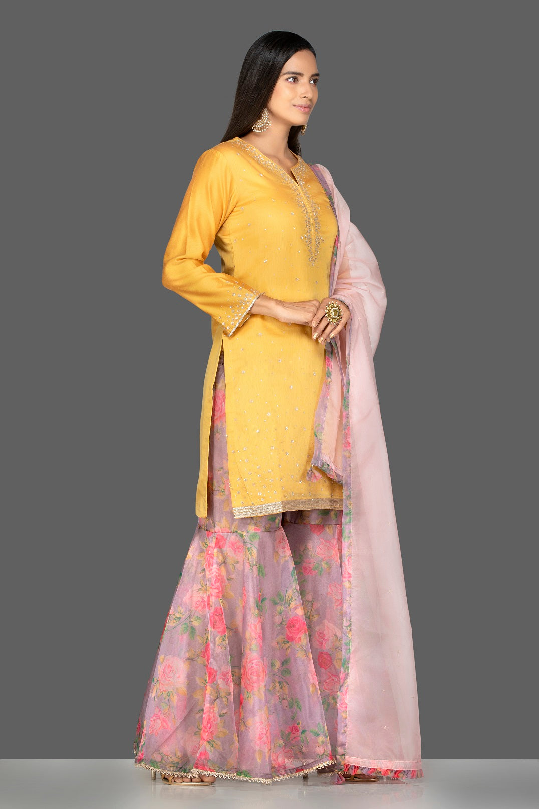 Buy gorgeous yellow embroidered suit online in USA with pink floral palazzo and pink dupatta. Flaunt ethnic fashion on weddings and festive occasions with latest designer lehengas, Indian dresses, traditional Anarkali suits from Pure Elegance Indian clothing store in USA.-side