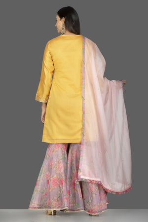 Buy gorgeous yellow embroidered suit online in USA with pink floral palazzo and pink dupatta. Flaunt ethnic fashion on weddings and festive occasions with latest designer lehengas, Indian dresses, traditional Anarkali suits from Pure Elegance Indian clothing store in USA.-back