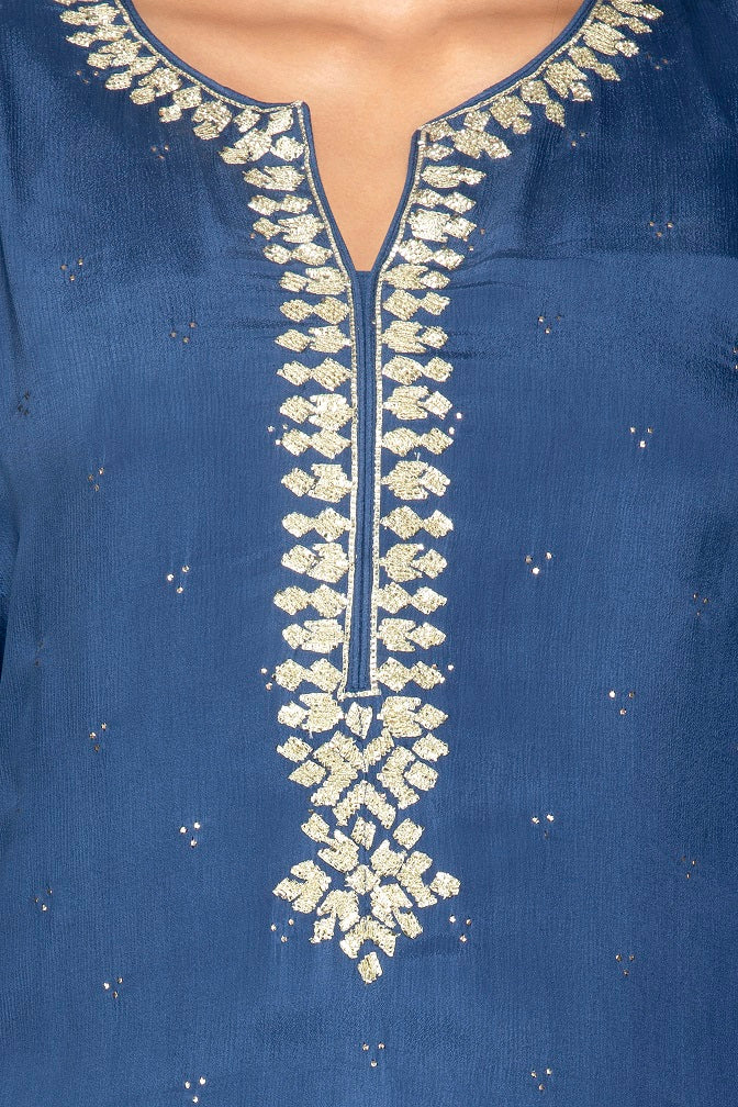Shop beautiful blue palazzo suit online in USA with silver embroidery and dupatta. Flaunt ethnic fashion on weddings and festive occasions with latest designer lehengas, Indian dresses, traditional Anarkali suits from Pure Elegance Indian clothing store in USA.-neckline