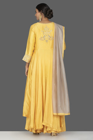 Buy beautiful yellow embroidered Anarkali suit online in USA with palazzo and grey dupatta. Flaunt ethnic fashion on weddings and festive occasions with latest designer lehengas, Indian dresses, traditional Anarkali suits from Pure Elegance Indian clothing store in USA.-back