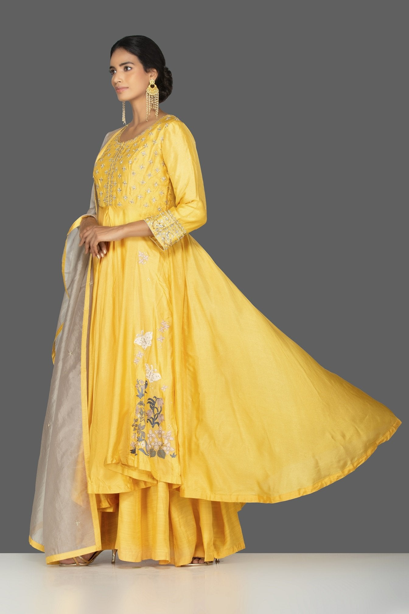 Buy beautiful yellow embroidered Anarkali suit online in USA with palazzo and grey dupatta. Flaunt ethnic fashion on weddings and festive occasions with latest designer lehengas, Indian dresses, traditional Anarkali suits from Pure Elegance Indian clothing store in USA.-side