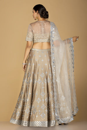 Shop gorgeous beige embroidered designer lehenga online in USA with white embroidered dupatta. Flaunt ethnic fashion on weddings and festive occasions with latest designer lehengas, Indian dresses, traditional Anarkali suits from Pure Elegance Indian clothing store in USA.-back