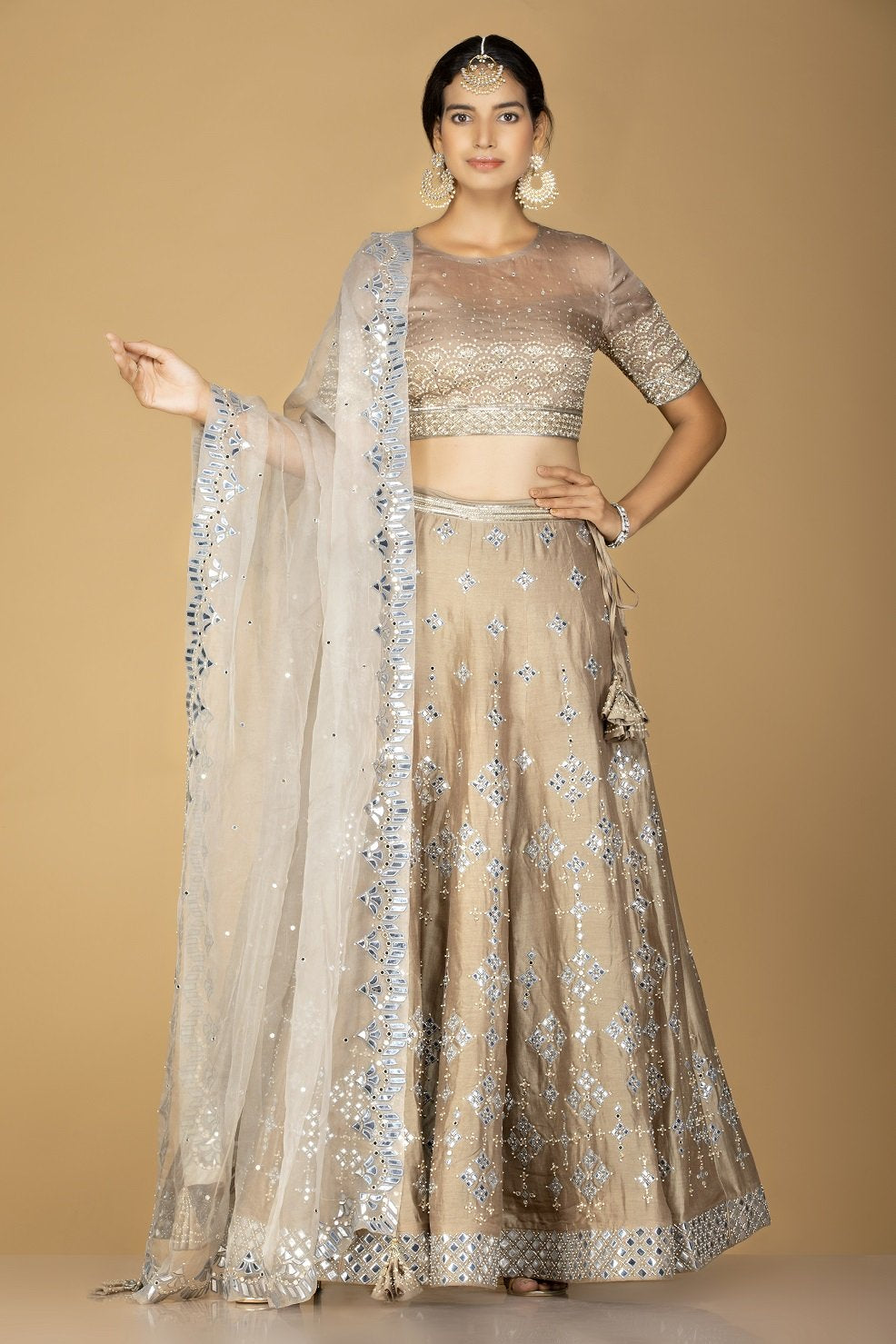 Shop gorgeous beige embroidered designer lehenga online in USA with white embroidered dupatta. Flaunt ethnic fashion on weddings and festive occasions with latest designer lehengas, Indian dresses, traditional Anarkali suits from Pure Elegance Indian clothing store in USA.-full view