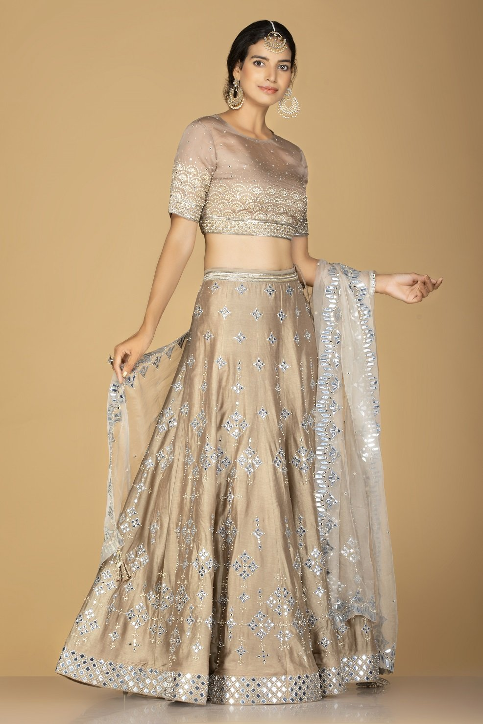 Shop gorgeous beige embroidered designer lehenga online in USA with white embroidered dupatta. Flaunt ethnic fashion on weddings and festive occasions with latest designer lehengas, Indian dresses, traditional Anarkali suits from Pure Elegance Indian clothing store in USA.-side