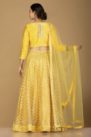 Shop splendid yellow embroidered lehenga online in USA with matching embroidered dupatta. Flaunt ethnic fashion on weddings and festive occasions with latest designer lehengas, Indian dresses, traditional Anarkali suits from Pure Elegance Indian clothing store in USA.-back