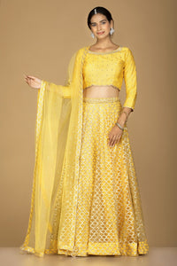 Shop splendid yellow embroidered lehenga online in USA with matching embroidered dupatta. Flaunt ethnic fashion on weddings and festive occasions with latest designer lehengas, Indian dresses, traditional Anarkali suits from Pure Elegance Indian clothing store in USA.-full view