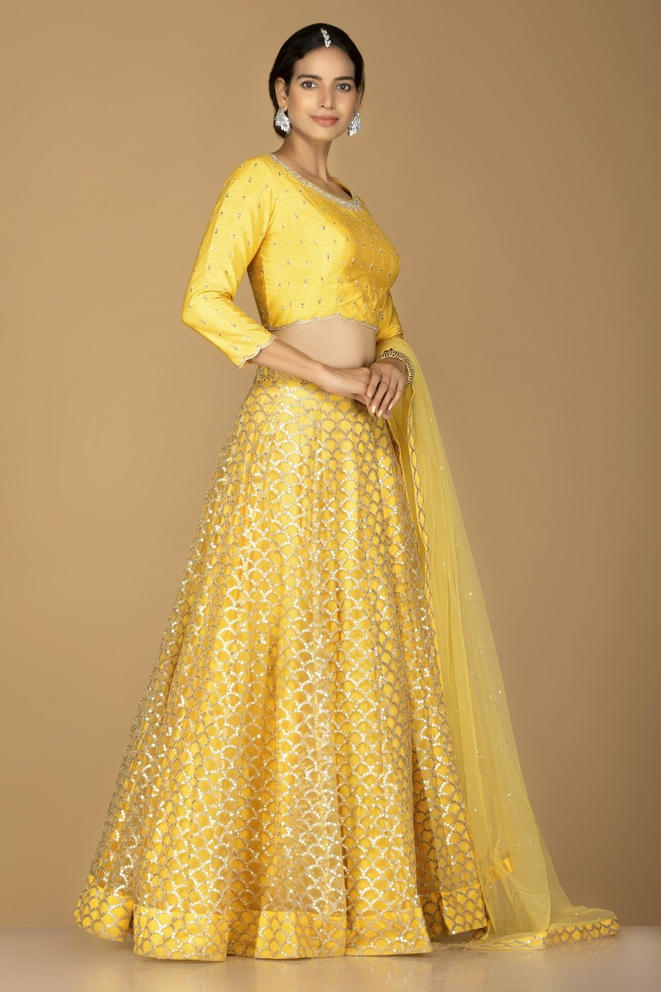 Shop splendid yellow embroidered lehenga online in USA with matching embroidered dupatta. Flaunt ethnic fashion on weddings and festive occasions with latest designer lehengas, Indian dresses, traditional Anarkali suits from Pure Elegance Indian clothing store in USA.-side