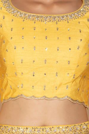Shop splendid yellow embroidered lehenga online in USA with matching embroidered dupatta. Flaunt ethnic fashion on weddings and festive occasions with latest designer lehengas, Indian dresses, traditional Anarkali suits from Pure Elegance Indian clothing store in USA.-blouse