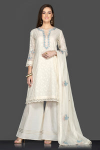 Buy elegant white embroidered palazzo suit online in USA with matching dupatta. Flaunt ethnic fashion on weddings and festive occasions with latest designer lehengas, Indian dresses, traditional Anarkali suits from Pure Elegance Indian clothing store in USA.-full view