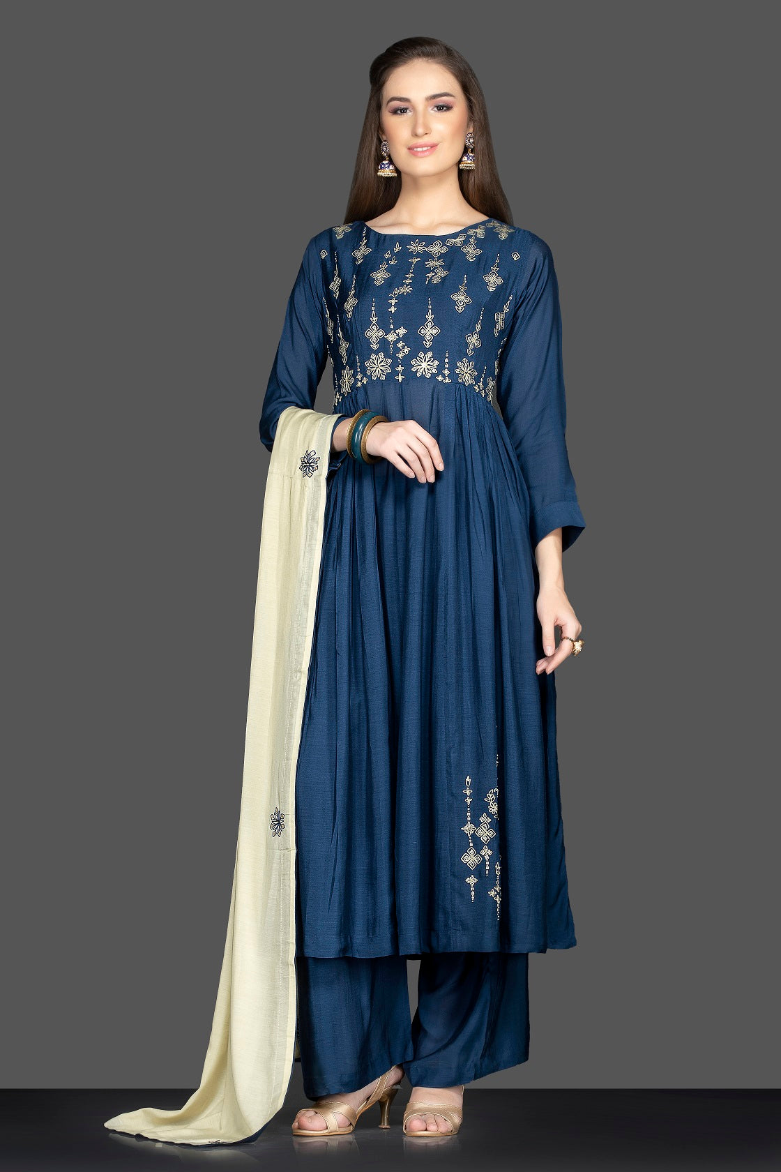 Buy lovely dark blue embroidered suit online in USA with palazzo and cream dupatta. Flaunt ethnic fashion on weddings and festive occasions with latest designer lehengas, Indian dresses, traditional Anarkali suits from Pure Elegance Indian clothing store in USA.-full view
