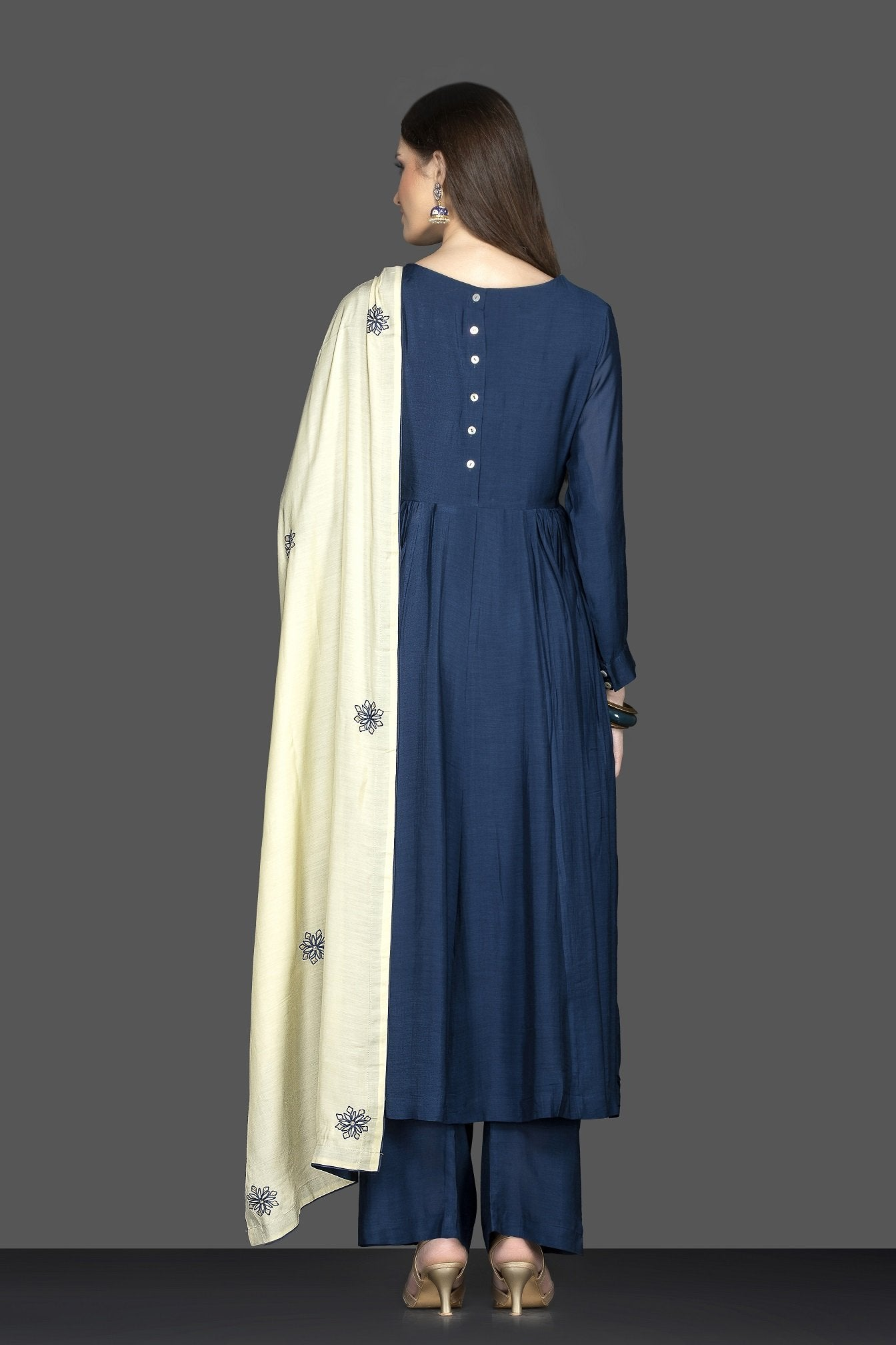 Buy lovely dark blue embroidered suit online in USA with palazzo and cream dupatta. Flaunt ethnic fashion on weddings and festive occasions with latest designer lehengas, Indian dresses, traditional Anarkali suits from Pure Elegance Indian clothing store in USA.-side