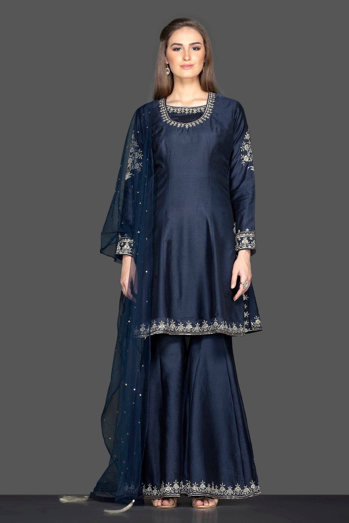 Buy stunning navy blue embroidered sharara suit online in USA with dupatta. Flaunt ethnic fashion on weddings and festive occasions with latest designer lehengas, Indian dresses, traditional Anarkali suits from Pure Elegance Indian clothing store in USA.-full view