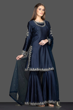 Buy stunning navy blue embroidered sharara suit online in USA with dupatta. Flaunt ethnic fashion on weddings and festive occasions with latest designer lehengas, Indian dresses, traditional Anarkali suits from Pure Elegance Indian clothing store in USA.-side