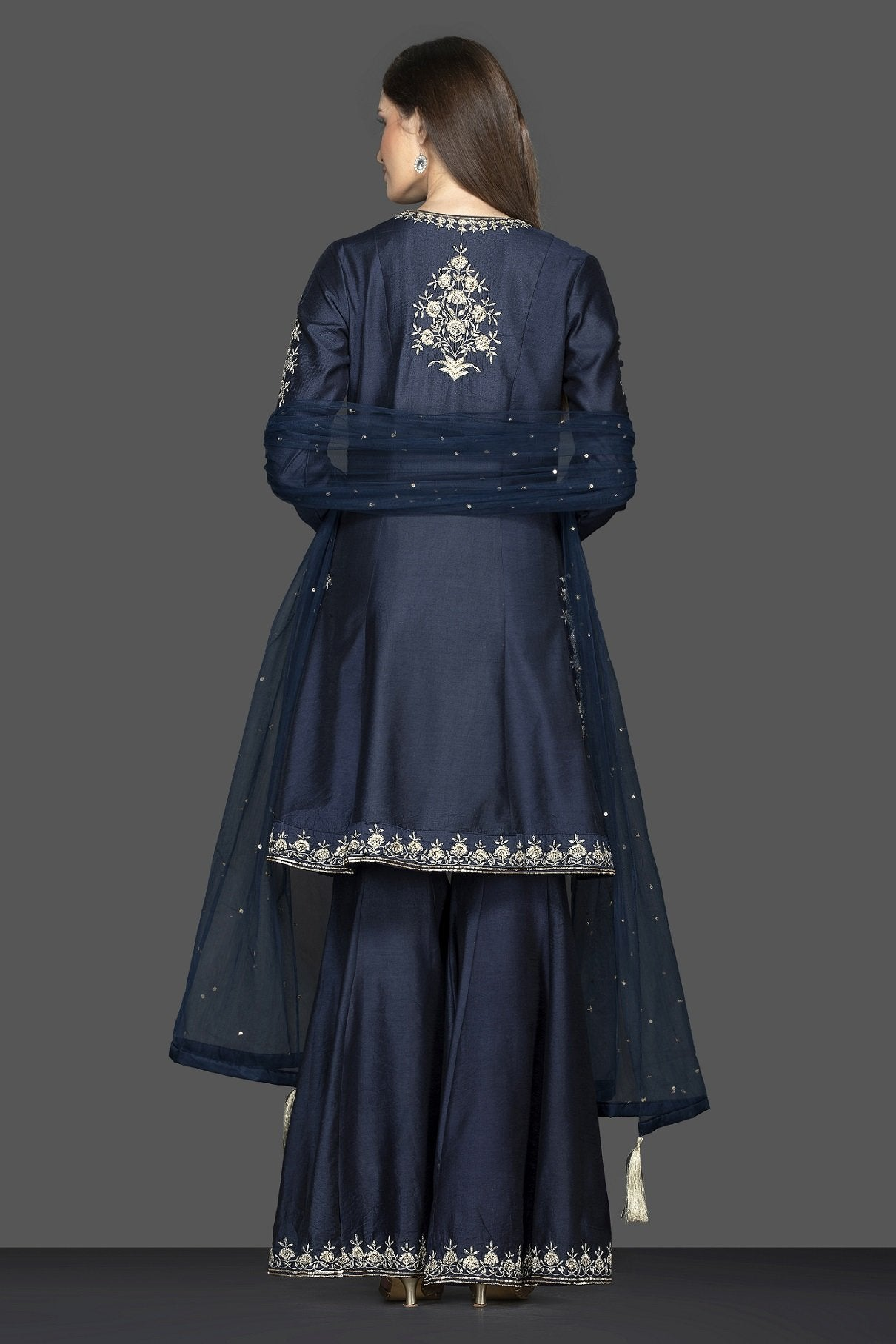 Buy stunning navy blue embroidered sharara suit online in USA with dupatta. Flaunt ethnic fashion on weddings and festive occasions with latest designer lehengas, Indian dresses, traditional Anarkali suits from Pure Elegance Indian clothing store in USA.-back