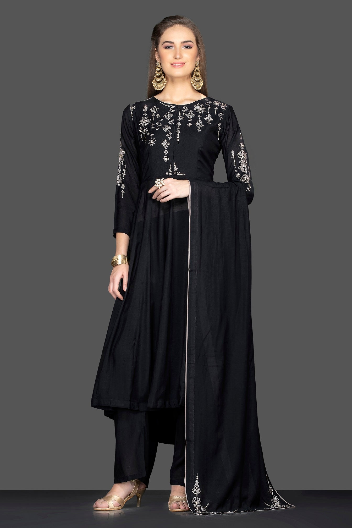 Shop ravishing black embroidered suit online in USA with matching palazzo and dupatta. Flaunt ethnic fashion on weddings and festive occasions with latest designer lehengas, Indian dresses, traditional Anarkali suits from Pure Elegance Indian clothing store in USA.-full view