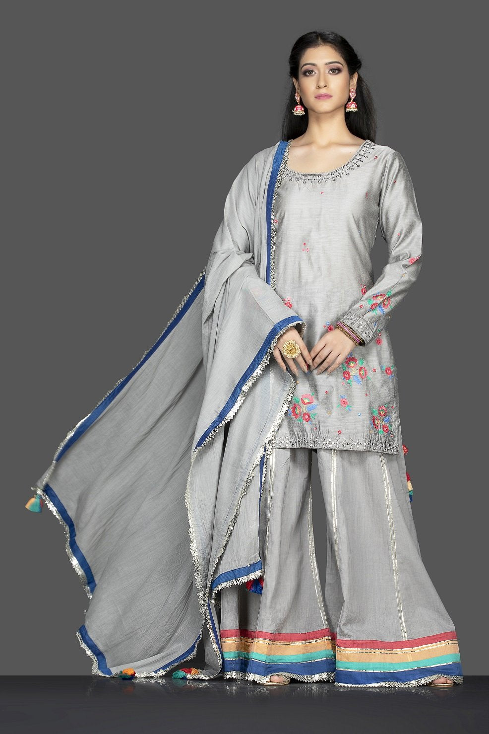 Shop beautiful steel grey embroidered sharara suit online in USA with matching palazzo and dupatta. Flaunt ethnic fashion on weddings and festive occasions with latest designer lehengas, Indian dresses, traditional Anarkali suits from Pure Elegance Indian clothing store in USA.-full view