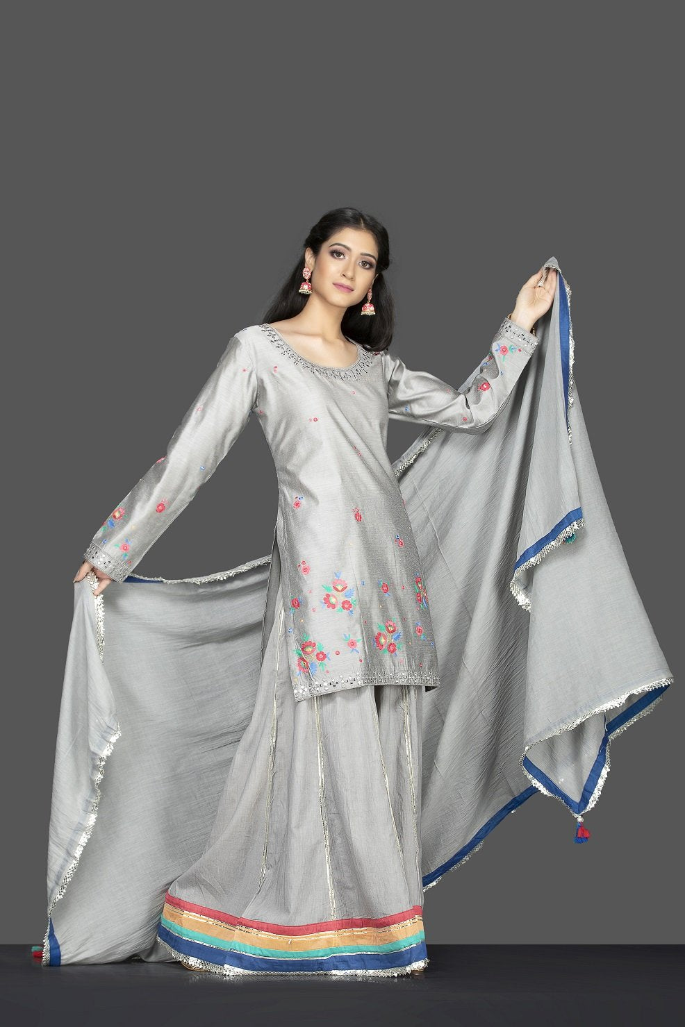 Shop beautiful steel grey embroidered sharara suit online in USA with matching palazzo and dupatta. Flaunt ethnic fashion on weddings and festive occasions with latest designer lehengas, Indian dresses, traditional Anarkali suits from Pure Elegance Indian clothing store in USA.-side