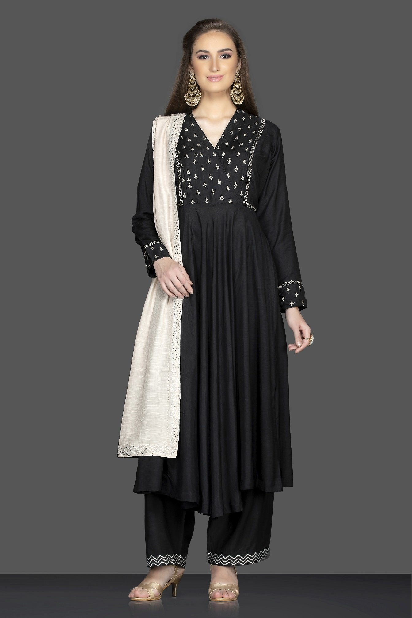 Shop stunning black embroidered Anarkali suit online in USA with cream dupatta. Flaunt ethnic fashion on weddings and festive occasions with latest designer lehengas, Indian dresses, traditional Anarkali suits from Pure Elegance Indian clothing store in USA.-full view