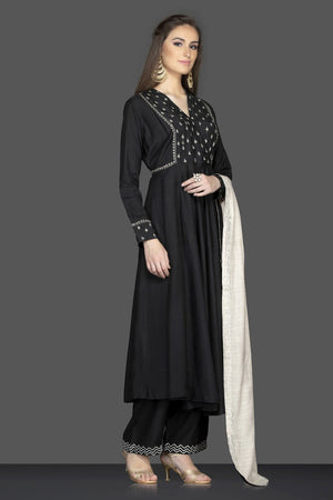 Shop stunning black embroidered Anarkali suit online in USA with cream dupatta. Flaunt ethnic fashion on weddings and festive occasions with latest designer lehengas, Indian dresses, traditional Anarkali suits from Pure Elegance Indian clothing store in USA.-side