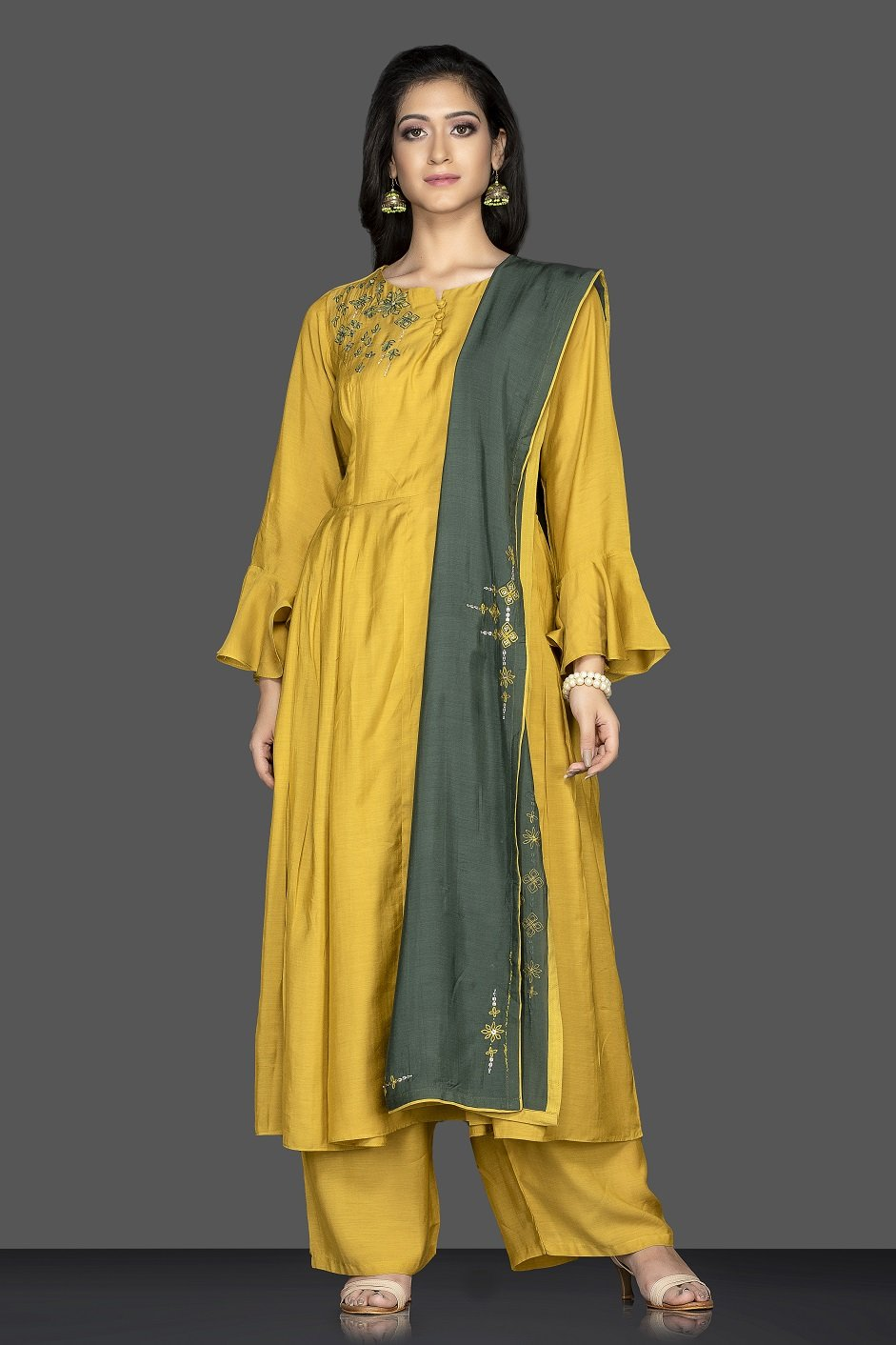 Buy bright and beautiful mustard flared sleeves embroidered suit online in USA with green dupatta. Flaunt ethnic fashion on weddings and festive occasions with latest designer lehengas, Indian dresses, traditional salwar suits from Pure Elegance Indian clothing store in USA.-full view