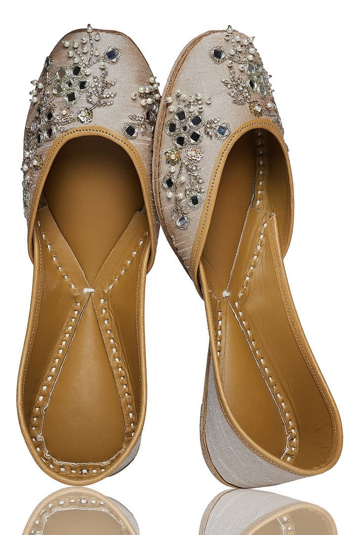 Shop nude shade mirror embroidery jutti online in USA with beadwork. Grab beautiful designer footwear and ethnic juttis in USA from Pure Elegance Indian fashion store in USA. Enhance your ethnic attires with exquisite accessories available on our online store.-full view
