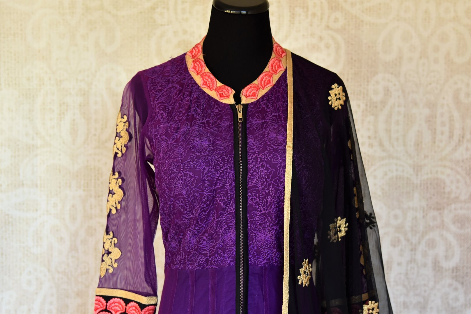 Buy purple embroidered Anarkali suit with churidaar online in USA and dupatta from Pure Elegance. Choose from a range of exclusive Indian designer suits, wedding dresses, Anarkali suits in beautiful styles and designs from our Indian fashion store in USA and flaunt your tasteful sartorial choices on special occasions.-front