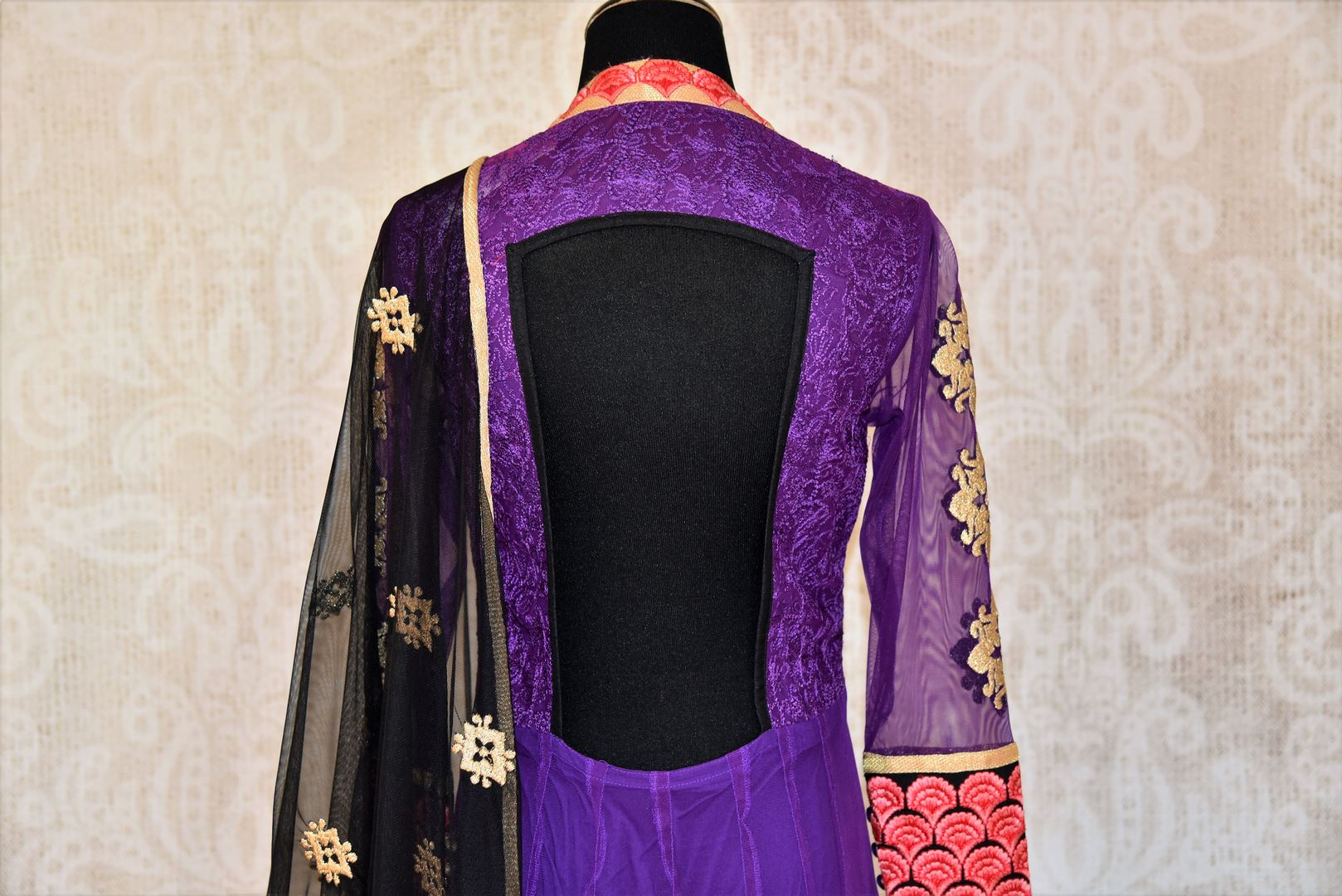 Buy purple embroidered Anarkali suit with churidaar online in USA and dupatta from Pure Elegance. Choose from a range of exclusive Indian designer suits, wedding dresses, Anarkali suits in beautiful styles and designs from our Indian fashion store in USA and flaunt your tasteful sartorial choices on special occasions.-back