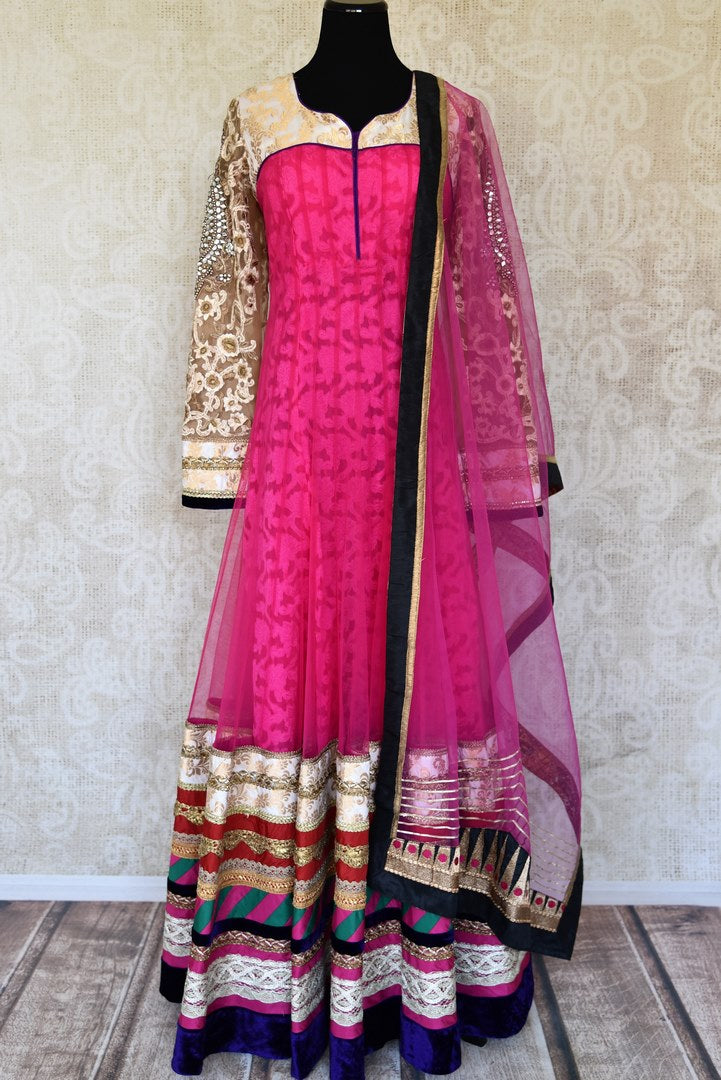 Buy pink embroidered net floor length Anarkali suit online in USA with dupatta from Pure Elegance. Choose from a range of exclusive Indian designer suits, wedding dresses, Anarkali suits in beautiful styles and designs from our Indian fashion store in USA and flaunt your tasteful sartorial choices on special occasions.-full view
