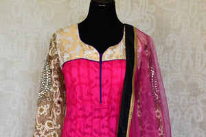Buy pink embroidered net floor length Anarkali suit online in USA with dupatta from Pure Elegance. Choose from a range of exclusive Indian designer suits, wedding dresses, Anarkali suits in beautiful styles and designs from our Indian fashion store in USA and flaunt your tasteful sartorial choices on special occasions.-front