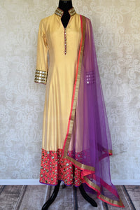 Buy beige and red silk suit online in USA with purple dupatta and mirror work from Pure Elegance. Choose from a range of exclusive Indian designer suits, wedding dresses, Anarkali suits in beautiful styles and designs from our Indian fashion store in USA and flaunt your tasteful sartorial choices on special occasions.-full view