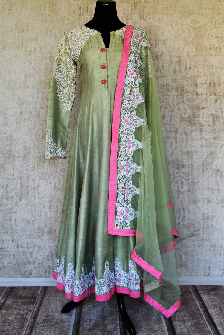 Buy pista green embroidered silk Anarkali suit online in USA with dupatta from Pure Elegance. Choose from a range of exclusive Indian designer suits, wedding dresses, Anarkali suits in beautiful styles and designs from our Indian fashion store in USA and flaunt your tasteful sartorial choices on special occasions.-full view