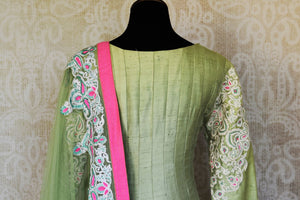 Buy pista green embroidered silk Anarkali suit online in USA with dupatta from Pure Elegance. Choose from a range of exclusive Indian designer suits, wedding dresses, Anarkali suits in beautiful styles and designs from our Indian fashion store in USA and flaunt your tasteful sartorial choices on special occasions.-back