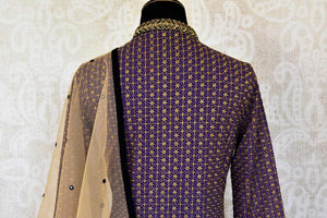 Buy traditional purple and black salwar suit online in USA with gold work from Pure Elegance. Choose from a range of exclusive Indian designer suits, wedding dresses, Anarkali suits in beautiful styles and designs from our Indian fashion store in USA and flaunt your tasteful sartorial choices on special occasions.-back