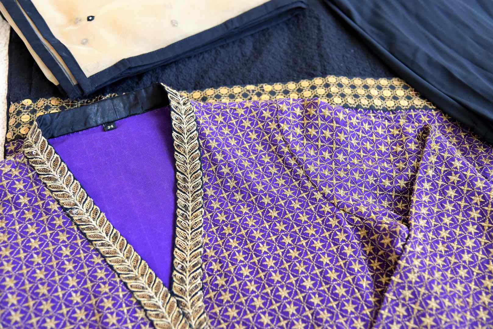 Buy traditional purple and black salwar suit online in USA with gold work from Pure Elegance. Choose from a range of exclusive Indian designer suits, wedding dresses, Anarkali suits in beautiful styles and designs from our Indian fashion store in USA and flaunt your tasteful sartorial choices on special occasions.-details
