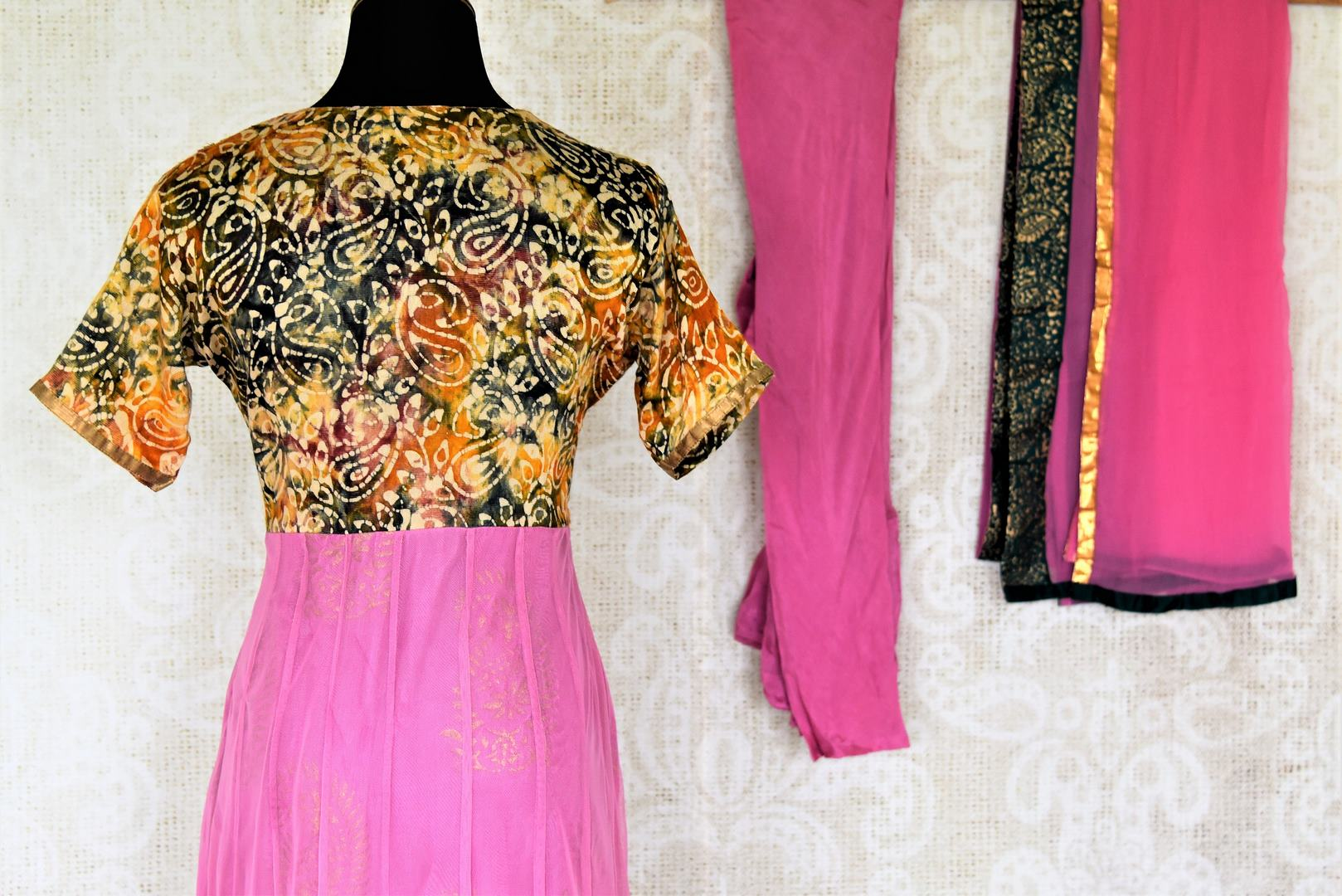 Shop beautiful pink Anarkali suit online in USA with embroidered bodice. Shop designer Indian suits, Anarkalis, palazzo suits, salwar suits from Pure Elegance Indian fashion store in USA.-back