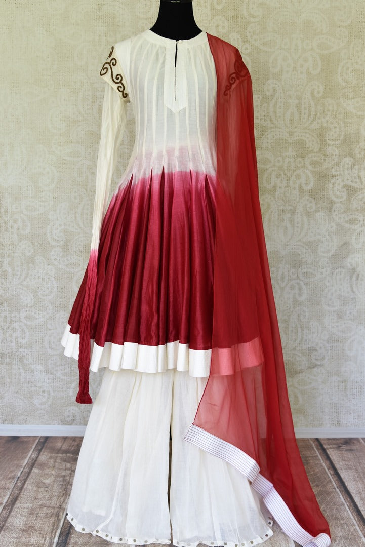Shop white and red silk sharara suit online in USA with red dupatta from Pure Elegance Indian fashion store in USA. Make a stylish fashion statement this summer with a range of exquisite Indian designer dresses available online and at our clothing store in USA. Shop now.-full view