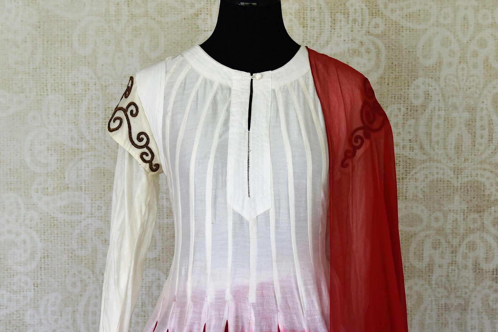Shop white and red silk sharara suit online in USA with red dupatta from Pure Elegance Indian fashion store in USA. Make a stylish fashion statement this summer with a range of exquisite Indian designer dresses available online and at our clothing store in USA. Shop now.-front