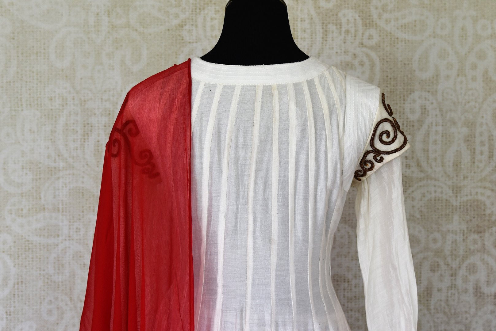 Shop white and red silk sharara suit online in USA with red dupatta from Pure Elegance Indian fashion store in USA. Make a stylish fashion statement this summer with a range of exquisite Indian designer dresses available online and at our clothing store in USA. Shop now.-back