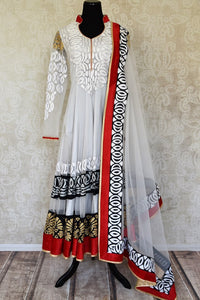 Buy white embroidered net Anarkali suit online in USA with red and black border from Pure Elegance. Choose from a range of exclusive Indian designer suits, wedding dresses, Anarkali suits in beautiful styles and designs from our Indian fashion store in USA and flaunt your tasteful sartorial choices on special occasions.-full view
