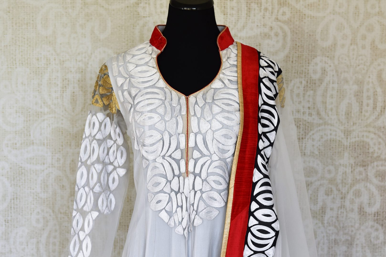 Buy white embroidered net Anarkali suit online in USA with red and black border from Pure Elegance. Choose from a range of exclusive Indian designer suits, wedding dresses, Anarkali suits in beautiful styles and designs from our Indian fashion store in USA and flaunt your tasteful sartorial choices on special occasions.-front