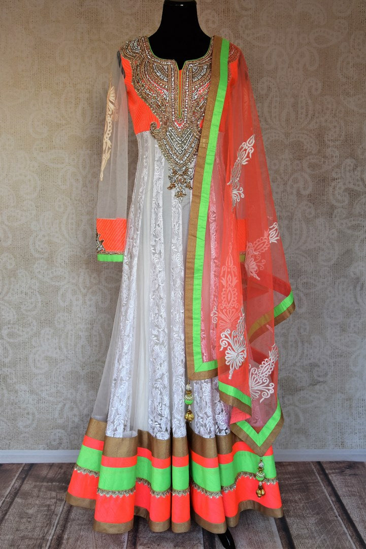 Buy white embroidered net floor length Anarkali suit online in USA with orange and green border from Pure Elegance. Choose from a range of exclusive Indian designer suits, wedding dresses, Anarkali suits in beautiful styles and designs from our Indian fashion store in USA and flaunt your tasteful sartorial choices on special occasions.-full view