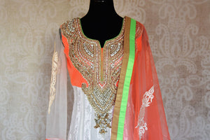 Buy white embroidered net floor length Anarkali suit online in USA with orange and green border from Pure Elegance. Choose from a range of exclusive Indian designer suits, wedding dresses, Anarkali suits in beautiful styles and designs from our Indian fashion store in USA and flaunt your tasteful sartorial choices on special occasions.-front