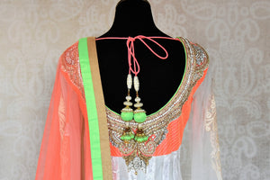 Buy white embroidered net floor length Anarkali suit online in USA with orange and green border from Pure Elegance. Choose from a range of exclusive Indian designer suits, wedding dresses, Anarkali suits in beautiful styles and designs from our Indian fashion store in USA and flaunt your tasteful sartorial choices on special occasions.-back