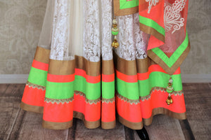 Buy white embroidered net floor length Anarkali suit online in USA with orange and green border from Pure Elegance. Choose from a range of exclusive Indian designer suits, wedding dresses, Anarkali suits in beautiful styles and designs from our Indian fashion store in USA and flaunt your tasteful sartorial choices on special occasions.-bottom