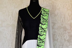 Shop black and white embroidered net floor length Anarkali suit online in USA with green border from Pure Elegance. Choose from a range of exclusive Indian designer suits, wedding dresses, Anarkali suits in beautiful styles and designs from our Indian fashion store in USA and flaunt your tasteful sartorial choices on special occasions.-front