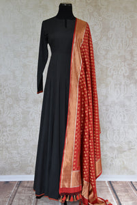 Black solid Suit with red trim on edge and Banarasi dupatta. Perfect suit for Indian parties and festivals.-Full view