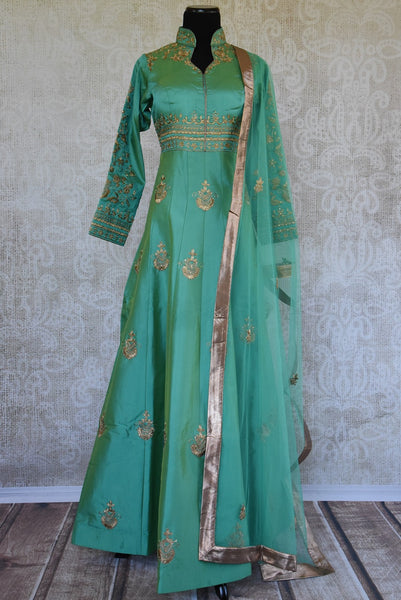 Green solid Suit with gold zari embroidery. Perfect suit for Indian parties and festivals.-full view