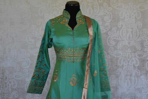 Green solid Suit with gold zari embroidery. Perfect suit for Indian parties and festivals.- neck style