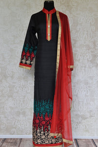 Shop black raw silk embroidered suit online in USA with red Dupatta. Shop ethnic Indian clothing for special occasions from Pure Elegance Indian fashion store in USA.-full view