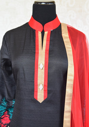 Shop black raw silk embroidered suit online in USA with red Dupatta. Shop ethnic Indian clothing for special occasions from Pure Elegance Indian fashion store in USA.-front